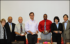 (L-R) Mary Sue Coleman, Amitabh Varshney, Michael Raupp, Nicholas Diakopolous, Rashawn Ray, Michele Gelfand, and Wallace Loh.