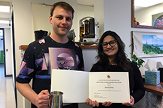 Dr. Farah Singer presents David Hymas with the Best Consortium Student Presentation Award.