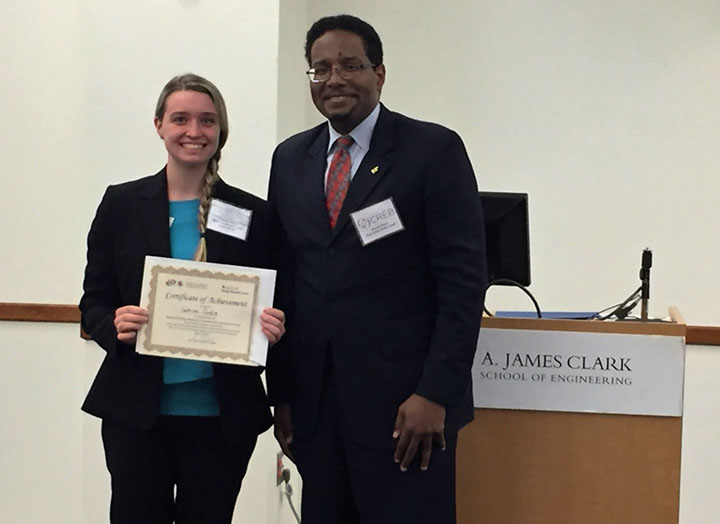 Dean Darryll Pines congratulates undergraduate Sabrina Curtis winner of poster contest