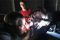 Lind and Trollinger, along with GLMWT co-op Noah Robinson, make adjustments to the rotor model in the Glenn L. Martin Wind Tunnel