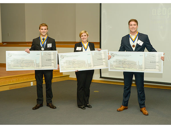 The undergraduate Gold Medalist, Sarah Adams (center); Silver Medalist, Peter Deaville and Bronze Medalist, Luke Hanner display their winnings from the U.S. Army Research Laboratory's 2017 Summer Student Symposium. (U.S. Army photo credit: Conrad Johnson)
