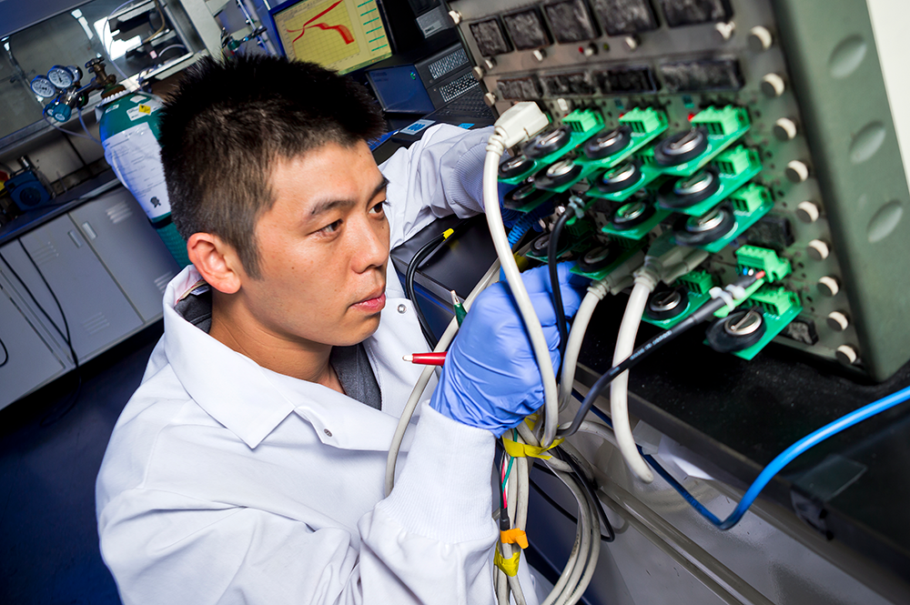 Postdoctoral Associate Fei Wang works on safe zinc batteries. Photo: John T. Consoli