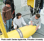 Naomi Leonard, center, on deck with one of the autonomous underwater vehicles.