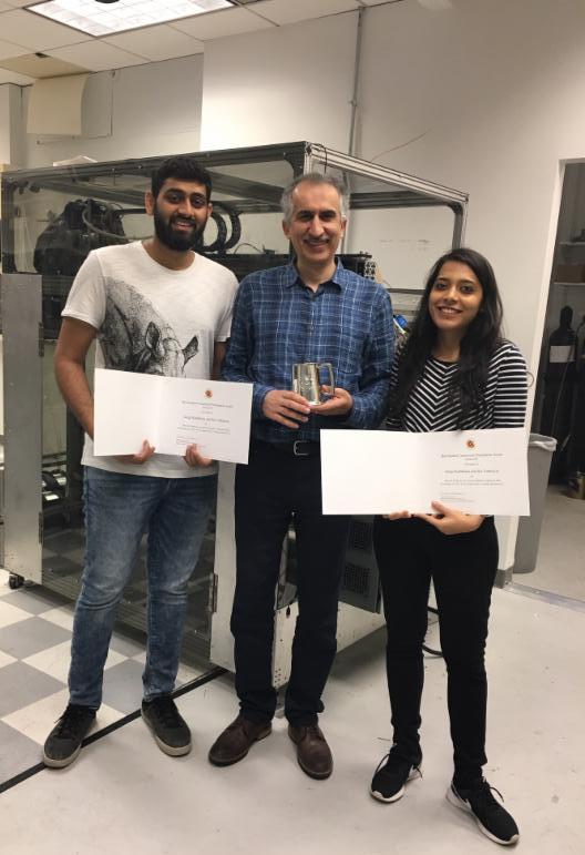 Best student presentation award winners, SaiVathsavai (left) and GargiKailkhura (right), with Research Professor Amir Shooshtari