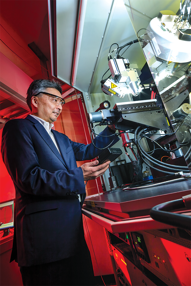 Professor Ichiro Takeuchi pictured with an X-ray diffractometer. Photo: John T. Consoli