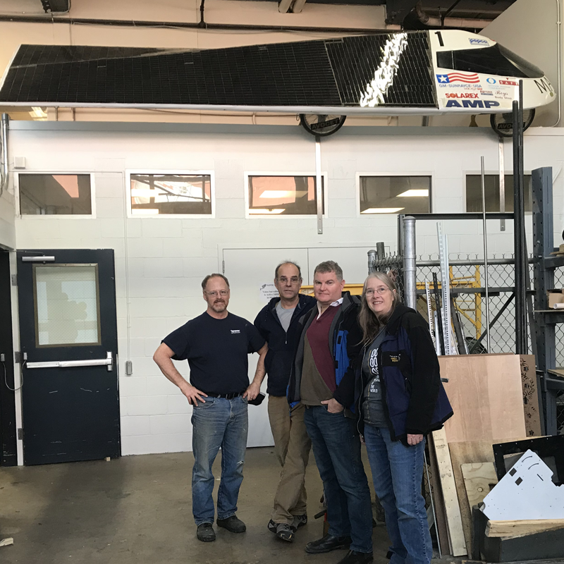 Pride of Maryland team alumni who assisted with the installation on January 20, 2020. From left to right: Bill Raynor (mechanical engineering, '91), Bernie LaFrance (civilian NAVY master machinist), Steve Brady (aerospace engineering, '89 and car driver), and Maureen Williams (mechanical engineering, '91, M.S., materials science, '99)