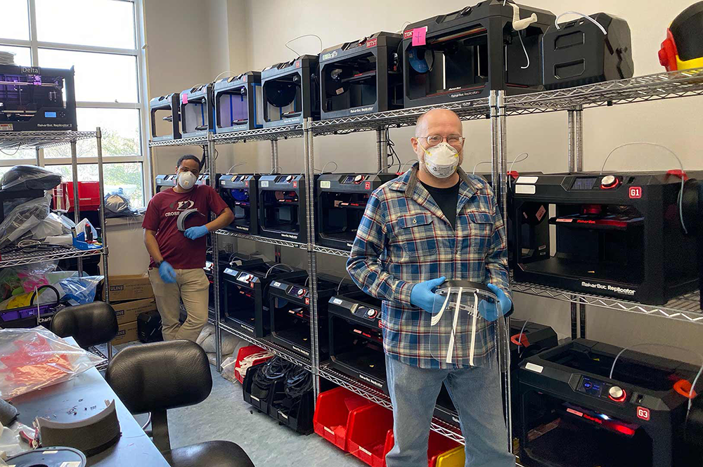 Terrapin Works staff Nathanael Carriere (left) and Andy Gregory attend banks of 3D printers turning out protective gear and other equipment for front-line personnel fighting the pandemic. (Photos courtesy of Terrapin Works)