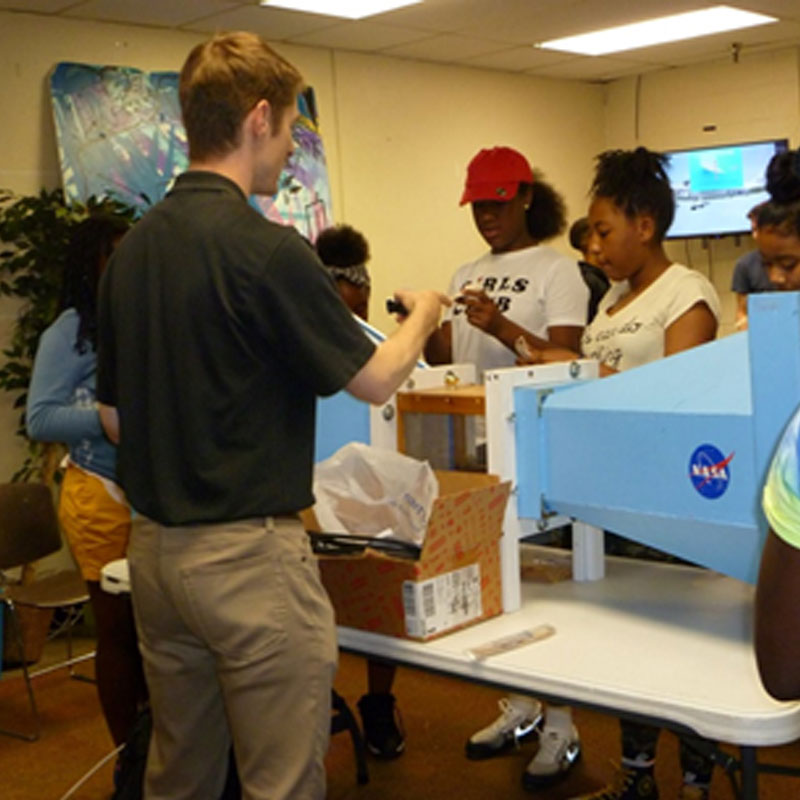 Dr. Becnel and UMD aerospace engineering students Edward Klapper, Shivam Soni and Ryan Turlik taught basic aerodynamics lessons to students in the Richard England Boys and Girls Club of Washington, D.C. using balsa gliders, a model wind tunnel and an air cannon to teach.