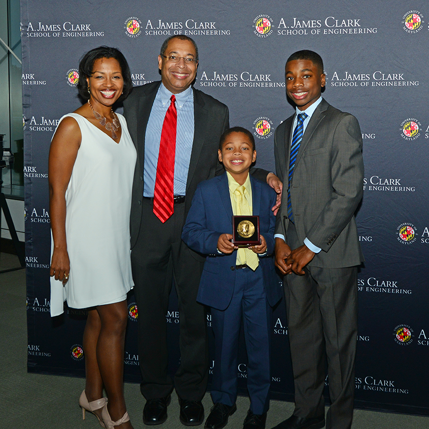 The Jones family (from left to right: Vernice, Chris, Anderson, and Maxwell) at Chris' 2016 induction into the Department of Aerospace Engineering's Academy of Distinguished Alumni. Photo: Al Santos