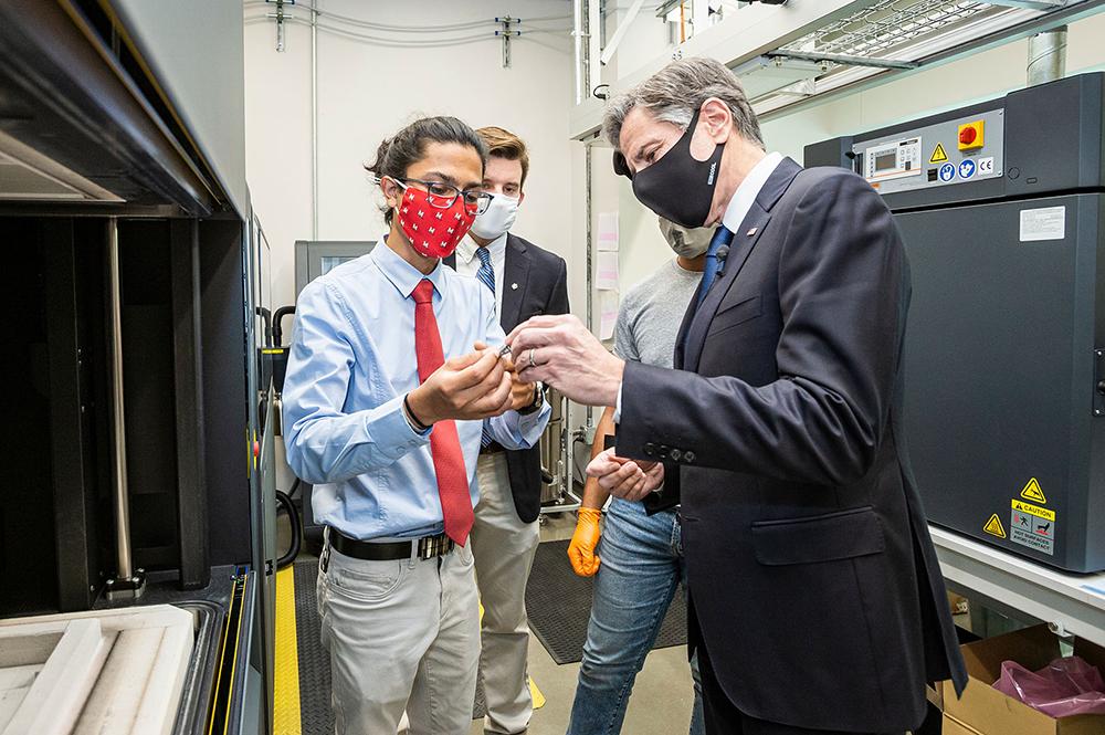 Aerospace engineering student Chinmay Sevak explains 3D printing to Secretary of State Antony Blinken in the Advanced Fabrication Lab. Photo: John T. Consoli