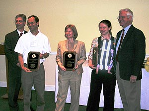 Prof. Abshire (second from right) and her team won the Invention of the Year award for their invention,