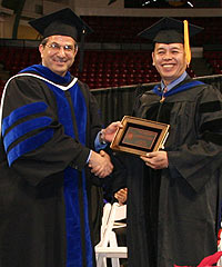Dr. Mel Gomez (right) with Dean Nariman Farvardin (left)