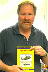 Dr. J. Gordon Leishman with his new book