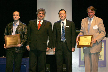 At the ICC 2007 Awards Ceremony are (left to right) Dr. George Theodorakopoulos, Dr. Roberto de Marca (chair of the Awards Committee of the IEEE ComSoc), Dr. Nim Cheung (President of the IEEE ComSoc) and Dr. John Baras.