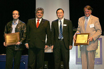 At the ICC 2007 Awards Ceremony are (left to right): Dr. George Theodorakopoulos, Dr. Roberto de Marca (chair of the Awards Committee of the IEEE ComSoc), Dr. Nim Cheung (President of the IEEE ComSoc) and Dr. John Baras.