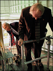 Keynote speaker Congressman Dr. Roscoe Bartlett (Md. 6th District; M.S. '49 and Ph.D. '52, Zoology; standing in front) examines the University's training reactor during a tour before the panel.