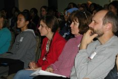 Students, parents and teachers listen attentively to WIE DREAM Conference speakers.