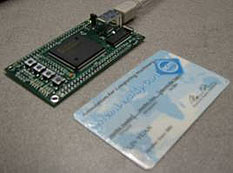 SecureGo prototype device next to credit card.