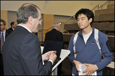 William Brody, president of Johns Hopkins University, speaks with a student after his lecture (Photo by Al Santos).