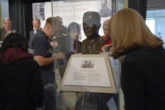 Students view the bust of Glenn L. Martin in its new display.