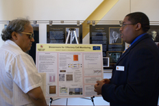 MERIT student from the University of Maryland, Armstard Skipwith (right), Jr. discusses summer research project,