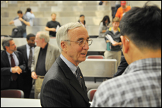 Gordon England '61 chats with students after the lecture (photo by Al Santos).