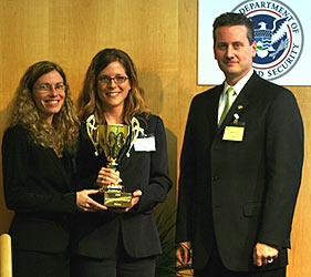 From left to right: TRX CEO Carole Teolis (Ph.D., E.E., '94), TRX COO Karina Drees, and Jeff David of TSWG. Photo courtesy Simon Schneider, Global Security Challenge.