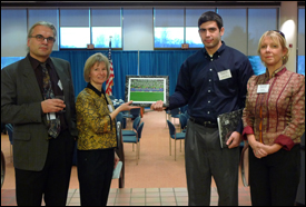 Stephan Koev with three members of the steering committee for the MEMS Alliance. Left to right: Applied Physics Lab Research Scientist Robert Osiander, Associate Professor Elisabeth Smela (ME), Stephan Koev, and APL's Ann Garrison Darrin, a co-founder of the MEMS Alliance.