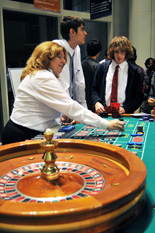 Students test their luck around the roulette table.