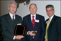 Bissell receives his Academy medallion in 2003 from chair William Fourney and Dean Nariman Farvardin