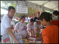 ECE student volunteers meet Maryland Day visitors at the information booth on Kim Plaza.