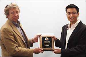 Professor and Chair Robert M. Briber (left) presents the Doctoral Thesis Award to Shenqiang Ren (right).