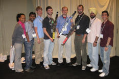 Left to right: Several graduate student members of the SAMPE Wing teams attended the SAMPE'09 conference: Nikesha Davis, Pathik Shah, Andrew Becnel, Ben Berry (holding 3rd place wing), Ben Woods (holding 1st place wing), Robbie Vocke (holding 2nd place wing), Harinder Singh, and Vince Posbic.