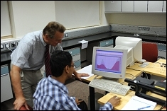 Dr. Anisimov and Adnan in the DLS Lab