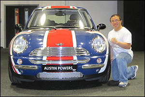 Quynh Nguyen (Ph.D. '03, chemical engineering) with Austin Powers' fab ride at the MINI Cooper manufacturing facility in Oxford, England.