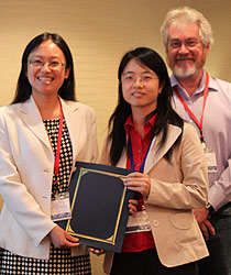 Dr. Yan Sun (left) receives the IEEE SocialCom 2010 Best Paper Award with co-author Yuhong Liu (right).