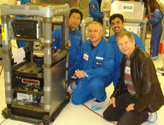 PHOTO 1 (ABOVE): Team members on the European Space Agency A300 aircraft in April 2010. From left to right:  Jungho Kim, Paolo DiMarco (professor, University of Pisa), Rishi Raj (graduate student), and Serguei Dessiatoun (research professor, U-Md.). (For the hi-res version, click here.) PHOTO 2: Rishi Raj (graduate student, center), Martin Karch (exchange student, left) and Jungho Kim (right) in the low-g environment on the European Space Agency A300 aircraft in March 2008. (For the hi-res version, click here.)