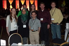 From left to right, front row: Amy Palumbo, Yasamin Ekrami, Ethan Schaler; back row: George Kinchen, Kathleen Hendrick, Dr. David Lovell, Brett Jansen