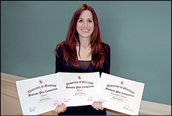PolyVec Solution's Irene Bacalocostantis with her awards.