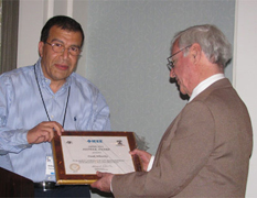 C. Frank Wheatley (right) was presented with the Pioneer Award from Mohamed Darwish, chairman of the IEEE convention, at the 23rd International Symposium on Power Semiconductor Devices & Ics on May 24, 2011, San Diego, Calif. Photo by Tom Wheatley.
