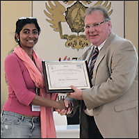 Deepa Subramanian (left) receiving the International Association of Chemical Thermodynamics Student Poster Award from Dr. Anthony Goodwin (right) of the International Union of Pure and Applied Chemistry.