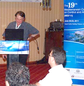 Baras gives invited plenary lecture at MED2011