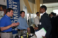A student speaks to recruiters at the Career Fair on February 10, 2012.