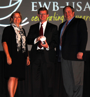 EWB advisor David Lovell accepts his award.