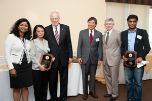 The winning team in the Information Sciences category poses with USM Chanellor Brit Kirwan, UMD President Wallace Loh and UMD Vice President for Research Pat O'Shea.