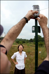 Mingyan Liu at one of the locations where soil moisture sensors have been placed in the ground. Photo credit: University of Michigan
