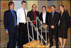 Mechanical engineering students with their Design Day project in 2011.