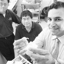 Jie Chen, left, Ying Tsui and Tarek El-Bialy with a model of the ultrasound device. Photo credit: Shaughn Butts, The Edmonton Journal