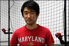 Eric Kim stands in the CPS & Cooperative Autonomy lab where he tests theories regarding cooperative robotics.