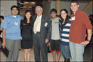 Dr. Fischell (center) with students at the 2012 Fischell Festival.